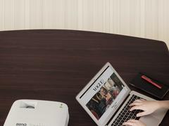 会议桌整洁如新的秘密,明基智能商务无线投影机